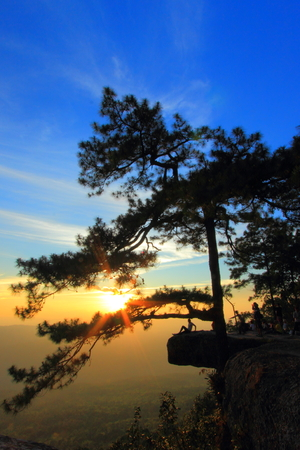 loei: Sunset at Pha Lom Sak cliff in Phu Kradueng in Loei province, Thailand
