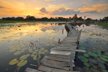 vedic: Architecture Bridge with sunset. Kae Dam District, Maha Sarakham, Thailand. Stock Photo