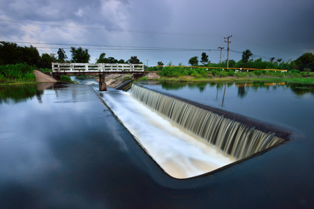 Dam catchment from which water is flowing. Stock Photo