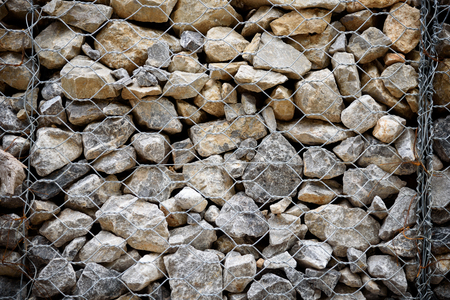 stabilize: Stone with wire mesh for protection rock falling from mountain