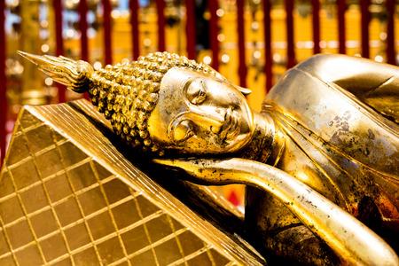buddha statue: Golden reclining Buddha statue in public temple