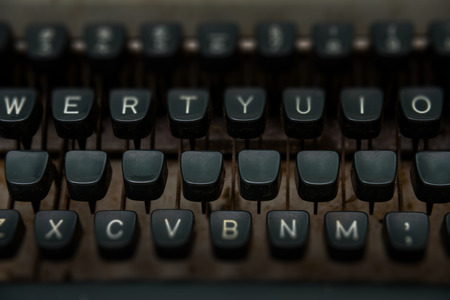 screenwriter: close up of keys of vintage typewriter with blank key for write your text.