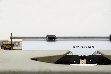shorthand: Close up of vintage typewriter with blank paper for input your text or your inscription.
