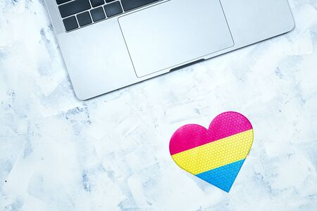Computer keyboard and love marks on an abstract background