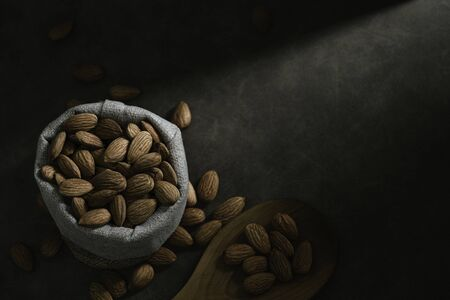 Dark tone almond photos, leaving space for text