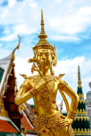 south east asian: Golden Kinnari statue at The Emerald Buddha Temple Wat Phrakaew in Grand royal palace, half girlhalf bird creature at south east asian buddhist mythology , Bangkok Thailand They are public domain or treasure of Buddhism, no restrict in copy or use