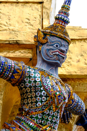 restrict: Thai giant statue at The Emerald Buddha Temple Wat Phrakaew, Bangkok Thailand They are public domain or treasure of Buddhism, no restrict in copy or use.