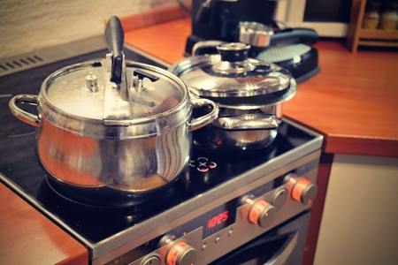 Pots on stove Standard-Bild