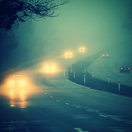 road traffic: Cars in the fog Stock Photo