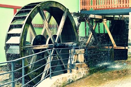waterwheel: Old beautiful wooden watermill Stock Photo
