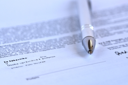 signature: Pen with signature on paper Stock Photo