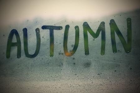 steamy: Autumn inscription on the steamy window Stock Photo