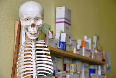medical distribution: Skeleton with pills in the background Stock Photo
