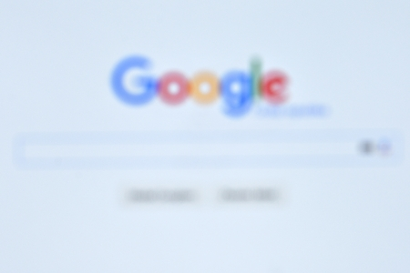 google chrome: The largest Internet search engine. Blurred background with the word Google.