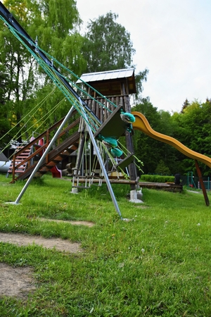 place for children: Swings playground.  A place for children to play outdoors.Nature - game.