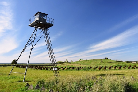 demarcation: Watchtower and line of defense, old state border of the Iron Curtain - barbed fence. Memorial military area - Satov Czech Republic. Stock Photo