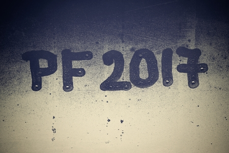 pf: PF 2017 written on a misty window. Background for the celebration of the New Year 2017