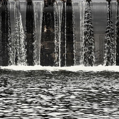 Weir - sluice on the river Stock Photo