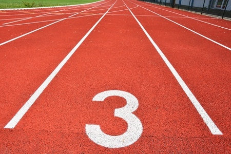 Running track with number 3. Colorful background for sport. Stockfoto