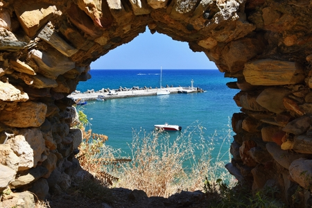 towards: Traditional beautiful Greek village of Panormos on the island of Crete. Summer background for travel and holidays.
