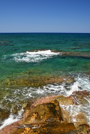 Beautiful clean sea and waves. Summer background for travel and holidays. Greece Crete.. Amazing scenery on the beach. Stock Photo