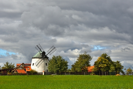 holland windmill: Old windmill - Czech Republic Europe. Beautiful old traditional mill house with a garden. Lesn - Czech Republic Stock Photo