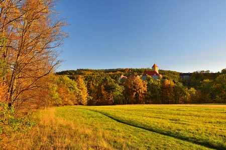 Beautiful Autumn Landscape with Veveri Castle. Natural colorful scenery with sunset. Brno dam-Czech Republic-Europe.