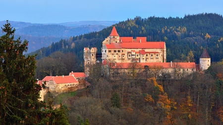 Beautiful old castle in forests with autumn landscape. Castle Pernstejn - Nedvedice. Europe Czech Republic.