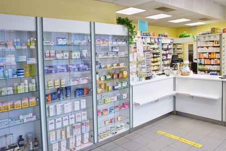 May 2, 2016 Brno Czech Republic. Interior of a pharmacy with goods and showcases. Medicines and vitamins for health. Shop concept, medicine and healthy lifestyle.