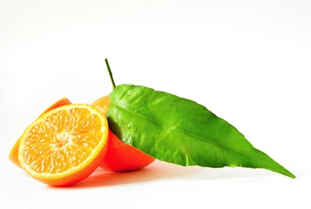 Beautiful fresh fruit - tangerine. Isolated on a clean background. Stock Photo