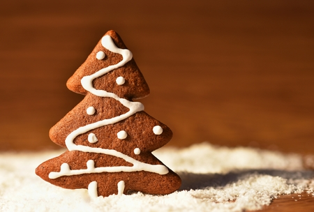 Christmas tree and snowflake. Beautiful sweet Christmas candy. Hand-decorated, homemade gingerbread.