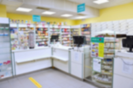 Blurred background. Interior of a pharmacy with goods and showcases. Medicines and vitamins for health. Shop concept, medicine and healthy lifestyle