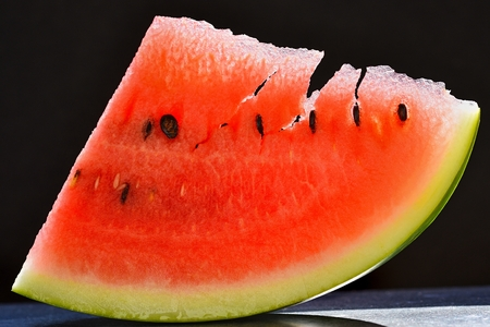 Beautiful red cut melon. Sweet refreshing and healthy fruit for the summer season. Stockfoto
