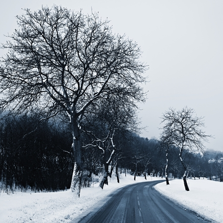 Road in winter. Snowy mountain path for a car. Concept for traveling and safe driving in winter by car.