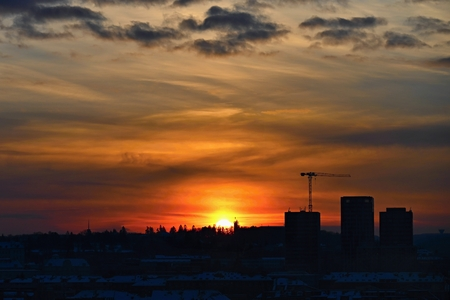 Construction of new houses with crane in the city at sunset. Concept for industry, construction and housing. Reklamní fotografie