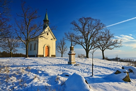 Beautiful winter landscape photo with church. Sunny winter day. Brno - L�e�. Chapel of Our Lady of Helper.