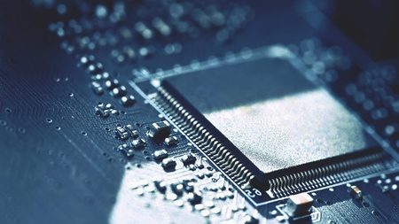 Printed Circuit Board with electrical components. Background concept for electrical engineering and modern technology