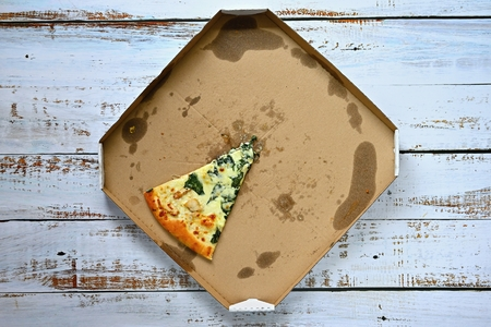Delicious fresh pizza in a box on a wooden background. Concept for food - fast food - home delivery.