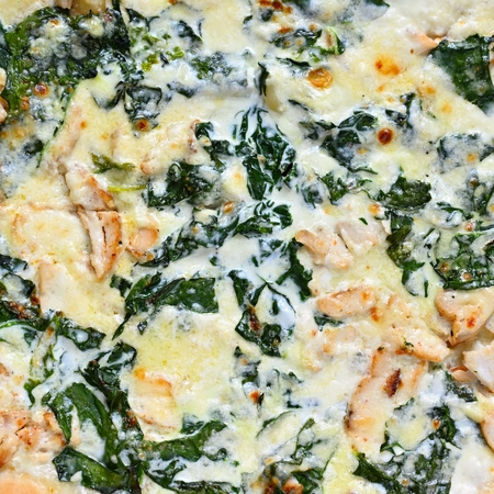 Close-up photos of food. Delicious fresh pizza with cream and spinach.