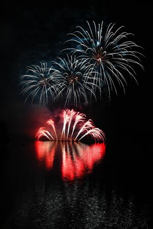 International competition of fireworks over the water surface. Brno Dam-Czech Republic-Brno. Beautiful colorful abstract fireworks. Concept for celebrations and holidays.
