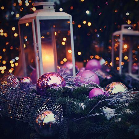 Christmas. Beautiful Christmas ornament on the Christmas tree. Seasonal background for winter holidays.