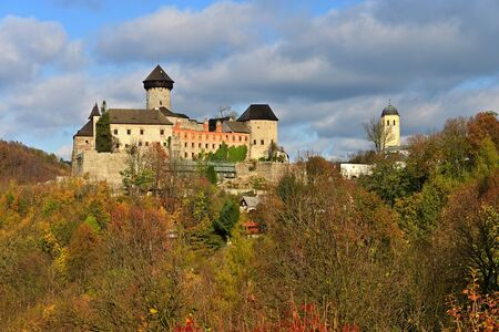 Beautiful old romantic castle Sovinec at sunset with autumn landscape.