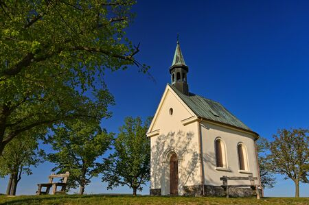 Beautiful little church with trees and blue sky. Brno-Lisen - Czech Republic. Chapel of Our Lady Help of Christians