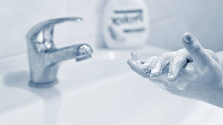 Thorough hand washing with disinfectant soap. Quarantine - domestic hygiene. Measures against coronavirus disease. (COVID-19) Standard-Bild - 146662627