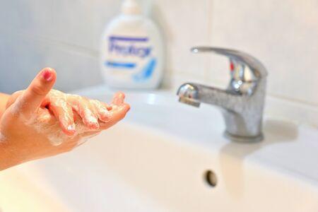 Thorough hand washing with disinfectant soap. Quarantine - domestic hygiene. Measures against coronavirus disease. (COVID-19)