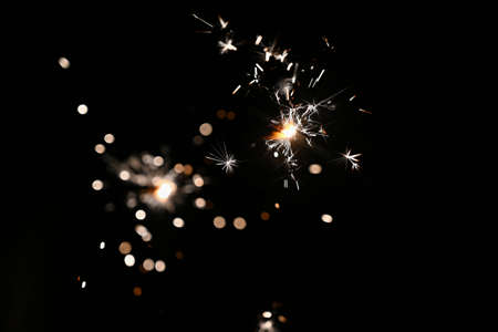 Sparkler - beautiful abstract background. Concept for Christmas and Happy New Year 2021. 写真素材