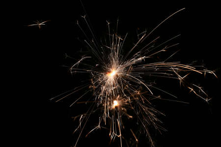 Sparkler - beautiful abstract background. Concept for Christmas and Happy New Year 2021. Reklamní fotografie