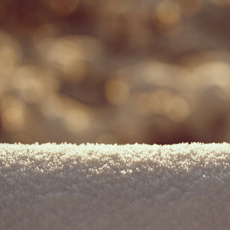 Beautiful clean winter background with real snow. Sun and outdoor nature bokeh.