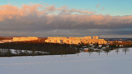 Landscape with houses and snow at sunset. Traditional housing estate. Living in the Czech Republic.