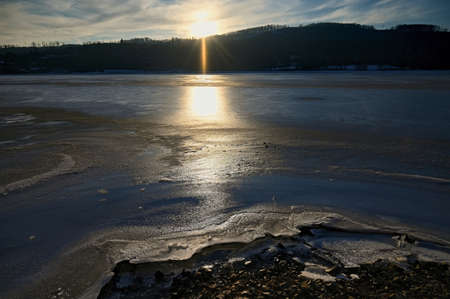 Winter landscape with frozen water. Brno Reservoir - dam. Czech Republic Europe.